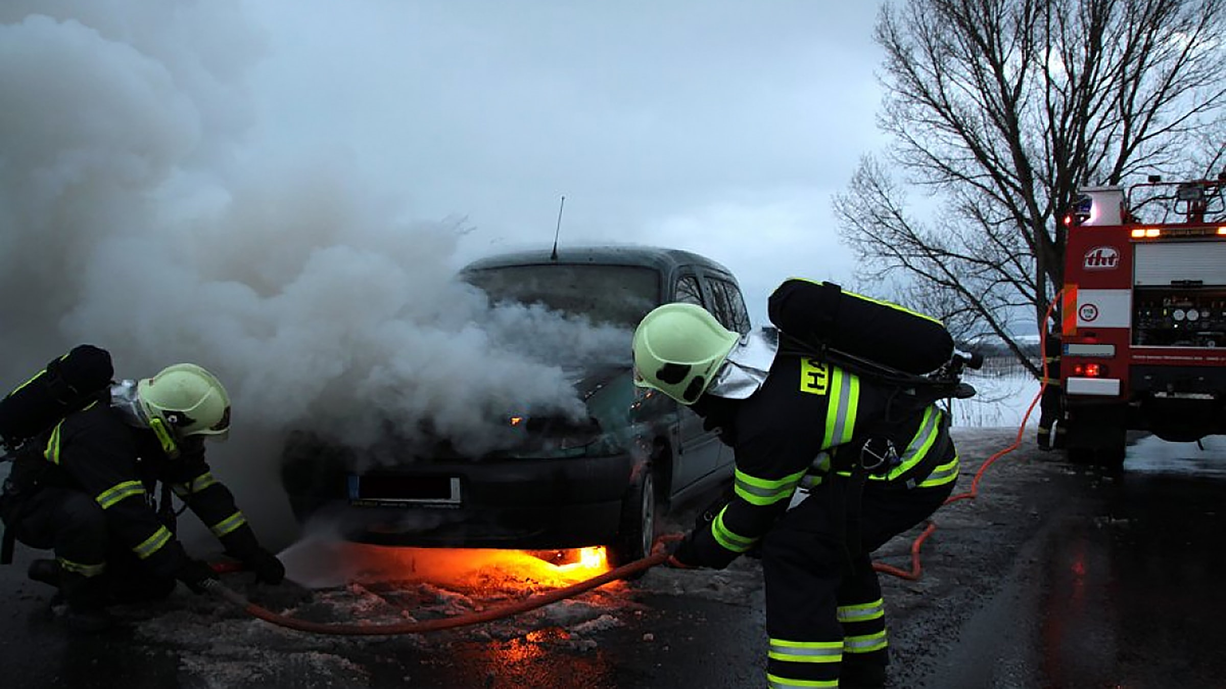 Fireman extinguishing a car fire