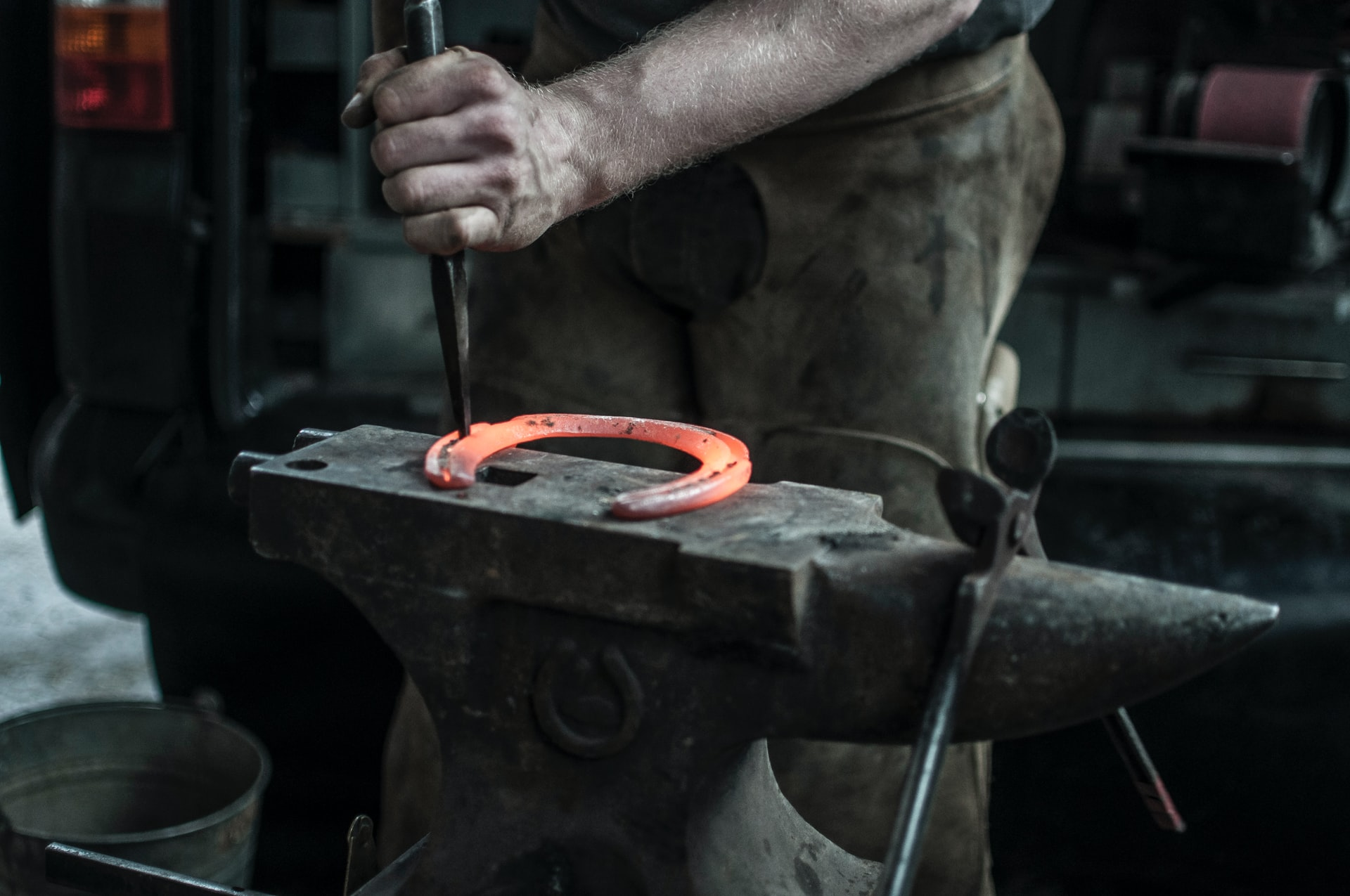 Blacksmith hitting on a incandescent piece of iron